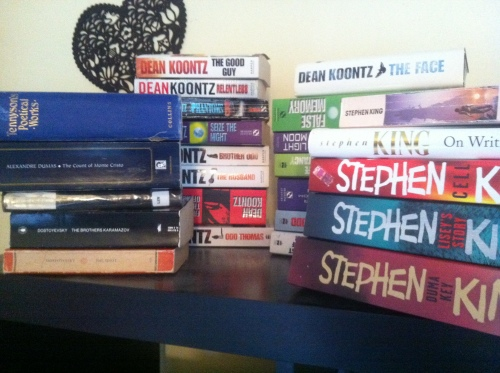 Piles of books by Stephen King, Dostoyevski and Dean Koontz